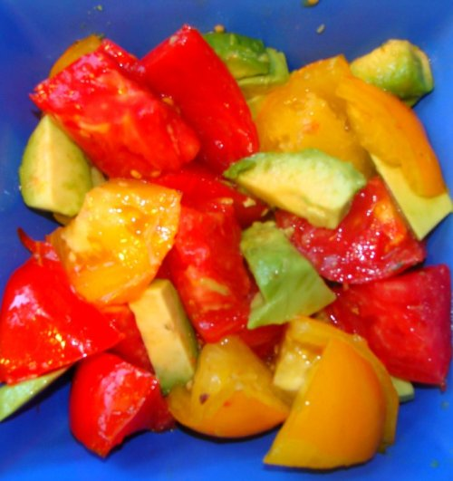 Yellow and red tomatoes with avocado.